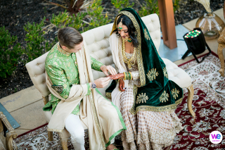 Northern California Elopement Photographers | the bride and groom dressed in traditional clothing seated outdoors
