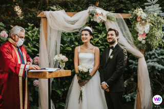 Romantic DIY Backyard Elopement Image - Istanbul, Turkey | During the outdoor ceremony, the bride and groom stand together before the priest