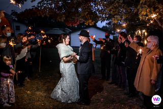 Minnesota Backyard Wedding Image | The couple dances for their guests by sparkler light