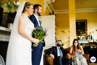 Gunthorpe Hall Weddings - Norfolk, UK Photography |  it is clear through their eyes that the two guests are smiling even though they are wearing face masks