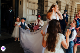 Wedding Photography at Nottingham City Council House | young kids play with the train on the brides dress