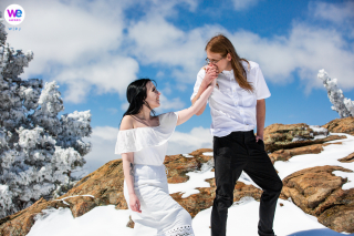 Mountain Wedding Photography in Morrison, CO | The groom kisses his wife's hand in between portraits