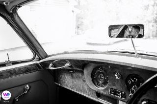 Hippensteal's Mountain View Inn | Wedding couple portrait inside of a classic Rolls Royce vehicle