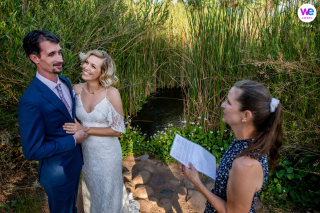 Intimate Ceremony Photography - Desert Botanical Gardens | The bride smiles at the groom during the wedding ceremony, which was officiated by her aunt
