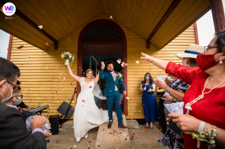 A Wedding Venue Image showing The bride and groom exiting the church with joy and flower petals