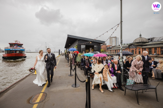 Wedding Ceremony Photo at ship Harbor of clear bubble umbrella to shield bride and groom from the rain