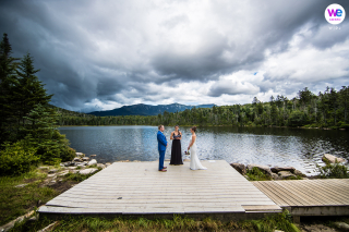 Adventure Wedding Photography showing they married on the dock at the Lake after hiking