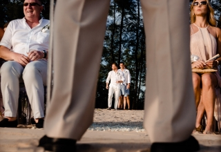 Wedding photograph with layers | Image of the groom coming into the ceremony outdoors