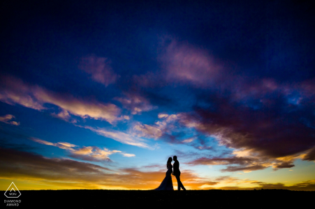 Colorful dramatic sky. Silhouette couple at sunset by Hangzhou City Engagement Photographer
