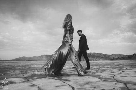 a Chelyabinsk couple walking on the cracked desert floor for engagement portraits