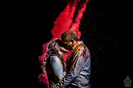 Boulder Engagement Photographer. Red smoke grenade used in outdoor night portrait.