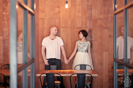 Hand-in-hand a couple poses for a prewedding portrait   Malaysia wedding photographer