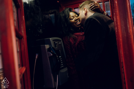 London Engagement Photography in a red phone booth.