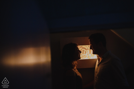 Norfolk Engagement Photographer. Indoor profile silhouette couple portraits in warm light.