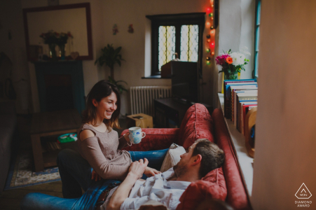 Indoor engagement session on the couch with a coffee for this pre-wedding shoot in England