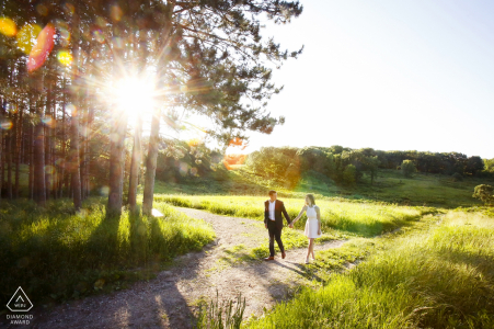 Madison Wisconsin engagement photography   pre-wedding portraits of a couple walking a gravel trail through the grass