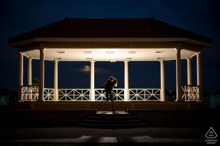 Night time engagement portrait in Boulder CO under a fully lit gazebo