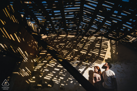 The wood roof of this Portugal building created wonderful shadows and patterns for this engagement portrait session