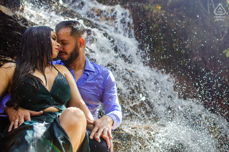 This Brazil couple gets drenched as they sit very close to a waterfall in their clothes during their engagement session
