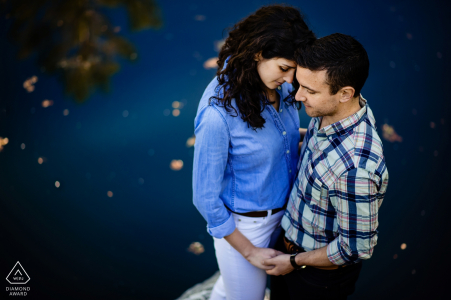 Engagement portrait shots from a high angle of this couple next to the water In Burlington Vermont