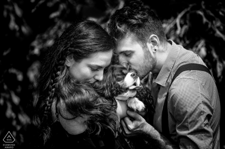 Lombardi engagement portrait with a couple kissing their dog