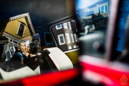 Reflections, cars, Windows and a kissing couple in this San Francisco engagement portrait