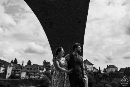french couple   engagement photography under a bridge