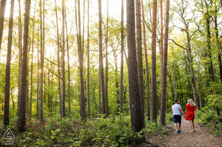 Check republic engaged couple walk a trail in the forest for their pre-wedding portrait session