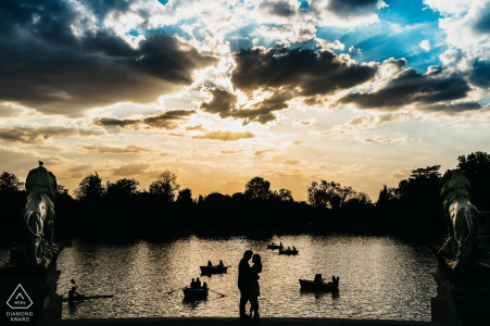 Madrid Spain pre-wedding silhouette portrait against the backdrop of Beautiful clouds water rowboats and paddlers