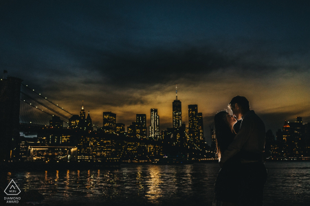 Pre-wedding engagement portrait at sunset with this city and bridge