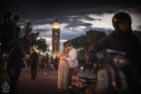 Engagement portrait session on the city streets of Venice with motorcycles and pedestrians