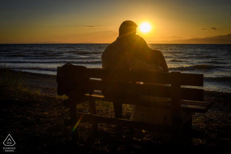 A bench at the beach is the perfect spot for a Sunset engagement portrait in Bulgaria