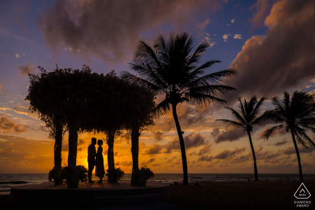 engagement shoot with a couple silhouetted at sunset with palms   Hangzhou City photographer pre-wedding session