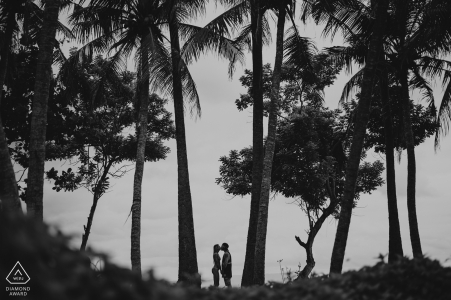 Indonesia tropical photoshoot | pre-wedding engagement pictures of a couple at the beach with palms | Bali portrait shoot