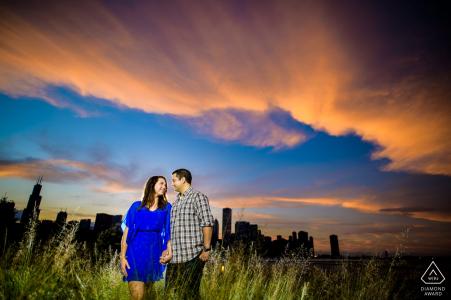 Shedd Aquarium Chicago Engagement Portrait of a young couple under a vibrant sky
