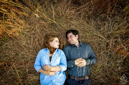 Photography Engagement Session Outdoor Fall   Engaged couple relaxes in a deer bed