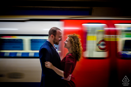 Portrait of a couple with moving subway train during engagement session in london