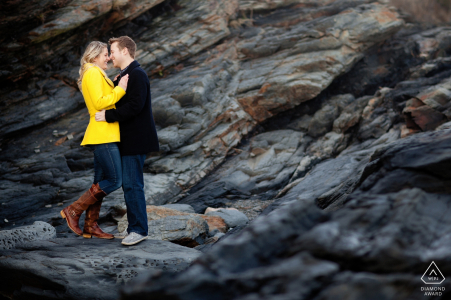 RI pre-wedding engagement pictures of a couple on the rocks at the beach    New England portrait shoot