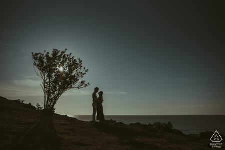 Indonesia wedding engagement portrait of a couple with a solo tree near sunset    Indonesia pre-wedding photographer session