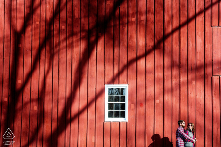Bucks County Engagement Session Pre-Wedding Portrait of a couple in front of a big red barn looking building