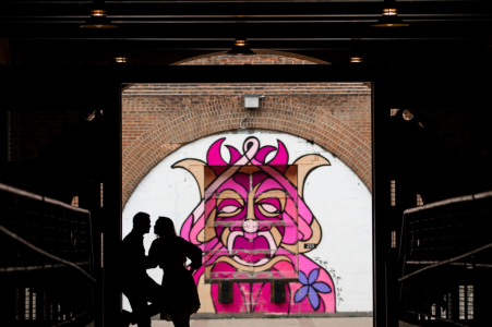 Couple silhouette with queen mural   MN engagement photographer