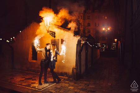Czech Republic pre-wedding engagement pictures of a couple with fire, flares and smoke    Prague portrait shoot