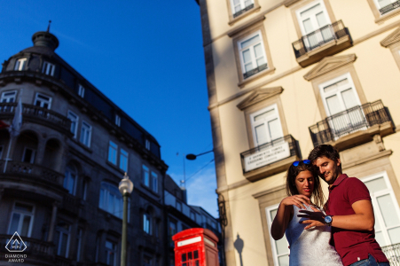Portugal engagement photos of a couple in the sun with buildings   Braga photographer pre-wedding portrait session