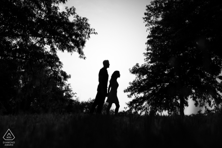 Portugal black and white engagement pictures of a couple silhouetted walking in the trees | Braga photographer pre-wedding photo shoot session