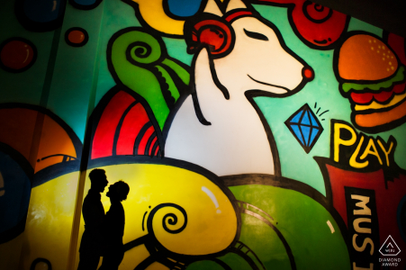 China wedding photographer engagement portrait of a couple with cartoon painted mural   Fujian pre-wedding pictures