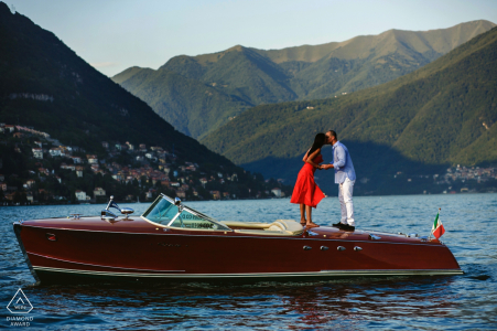 Como Lake engagement photography shoot with a couple kissing in a boat