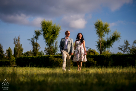 Blue sky with clouds for this outdoor walk-around at sunset | Engagement Portrait at Borgo Santo Pietro
