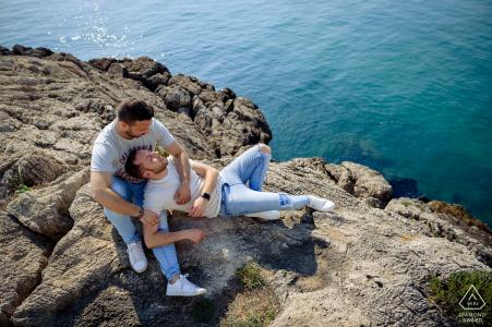 Engagement portrait on the rock cliffs over the sea