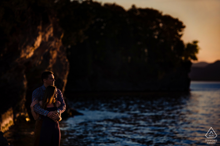 Vermont engagement picture of a couple embracing at sunset by the beach