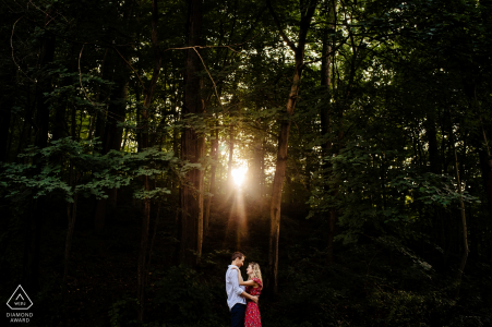 Vermont pre wedding photo of a couple in the woods in the sunshine